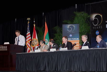 "At the podium, Russell Romanella, director of International Space Station and Spacecraft Processing at Kennedy Space Center, moderates a panel presenting ""Pushing the Limits of Knowledge To Inspire New Generations"" during NASA's Future Forum in Miami."