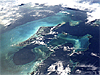 Picture taken from space showing dark blue and aqua blue waters off Andros Island in the Bahamas