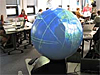 A large globe with people in the background