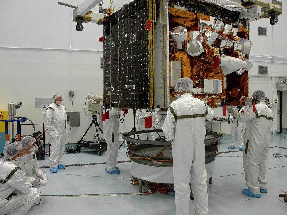 Technicians work on the GLAST spacecraft.