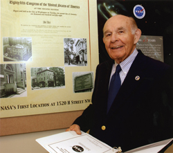 Proud architect - Space Act author Paul Dembling during NASA's early years and today, where he admires a poster highlighting NASA's founding legislation and the agency's first headquarters at the Dolly Madison House.