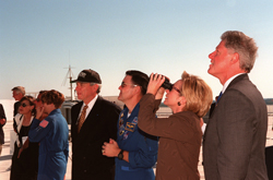 Launch day visit - Watching the launch of space shuttle Discovery and its crew, which included astronaut and Senator John Glenn (on Oct. 29, 1998) are astronaut Eileen Collins (in flight suit) with unidentified companions, NASA Administrator Daniel Goldin, astronaut Robert Cabana, first lady Hillary Rodham Clinton and President Bill Clinton.