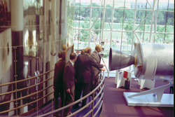 Grand opening - President Gerald Ford opens the new Smithsonian National Air and Space Museum (July 1, 1976). Ford, with Smithsonian Secretary Dillion Ripley and museum director, Apollo 11 astronaut Michael Collins, view a portion of the Apollo-Soyuz spacecraft.