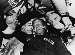 Détente in space - After linking up in orbit, Apollo-Soyuz Test Project astronauts Thomas Stafford and Deke Slayton greet Soviet cosmonaut Alexei Leonov (July 17, 1975).