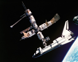 Shuttle-Mir hookup The space shuttle Atlantis (STS-71) connected to Russia's Mir space station, photographed by the Mir-19 crew (July 4, 1995).