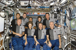 Team photo Members of the STS-114 and Expedition 11 crews in the International Space Station's Destiny Laboratory (July 2006). From the left (front row) are astronauts Andrew Thomas, Eileen Collins, cosmonaut Sergei Kriklev (Expedition 11) and astronaut John Phillips (Expedition 11). From the left (back row) are astronauts Soichi Noguchi (Japan), James Kelly, Charlie Camardo, Wendy Lawrence and Stephen Robinson.
