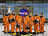 The crew of STS-124 in orange launch and entry suits