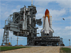 The space shuttle Discovery sits on the launch pad