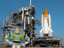 Buzz Lightyear standing in front of a space shuttle on the launch pad