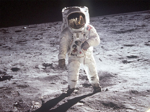 Astronaut Edwin E. Aldrin, Jr., lunar module pilot, walks on the surface of the Moon near the leg of the Lunar Module