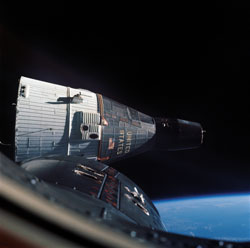 Gemini twins - The Gemini VII spacecraft (astronauts Frank Borman and James Lovell) viewed from Gemini VI (carrying astronauts Wally Schirra and Thomas Stafford) during NASA's first space rendezvous on Dec. 15, 1965. During their mission, Borman and Lovell lived in cramped quarters for 14 days.