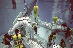 Simulated spacewalk - Astronauts Takao Doi and Winston Scott participate in an underwater simulation of a scheduled spacewalk for STS-87). They are accompanied by divers in the Neutral Buoyancy Laboratory at the Johnson Space Center's Sonny Carter Training Center.