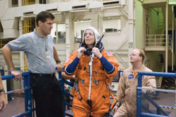From teacher to astronaut - Barbara Morgan, STS-118 mission specialist, training for her flight, assisted by United Space Alliance personnel.