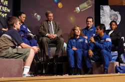 Earth crew - Astronauts with education backgrounds Dottie Metcalf-Lindenburger, Ricky Arnold, and Joe Acaba (with microphone) participate in an Earth Crew Web cast at NASA Headquarters in 2004. Webcast moderator Bianca Baker (left) then-Assistant Associate Administrator for Space Flight Tom Cremins (center) and students also took part.