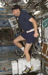 An astronaut exercising on the International Space Station.