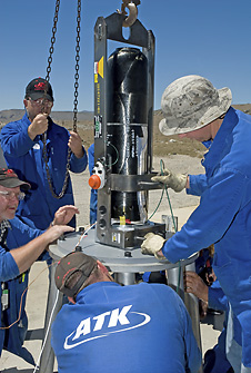 Technicians prepare the launch abort system igniter