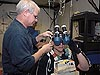 Homan setting up a virtual reality device on Behnken's head