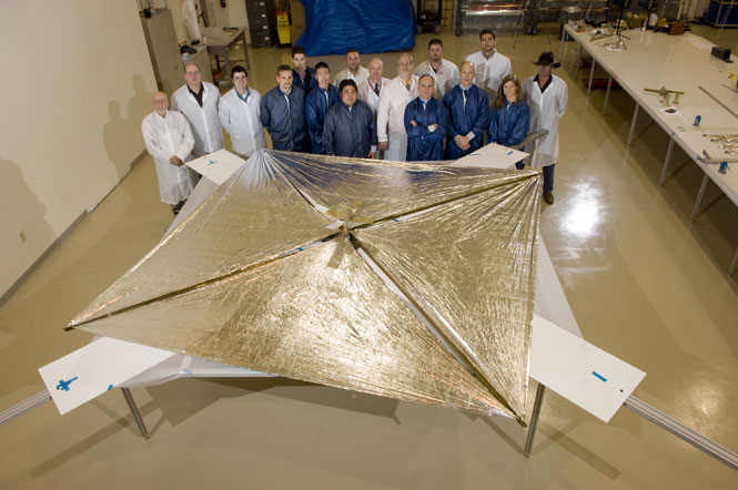 Huntsville-based NanoSail-D team stands with the fully deployed sail after successful deployment test.