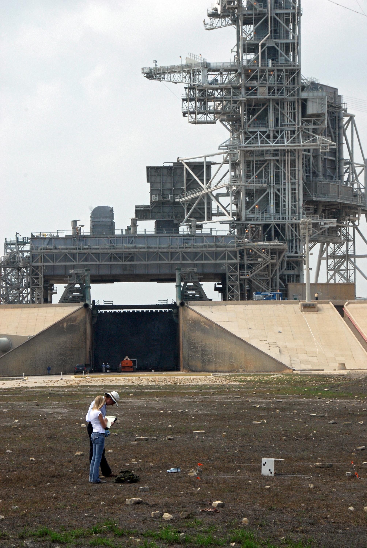 NASA - Workers Catalog Debris Outside the Perimeter of ...
