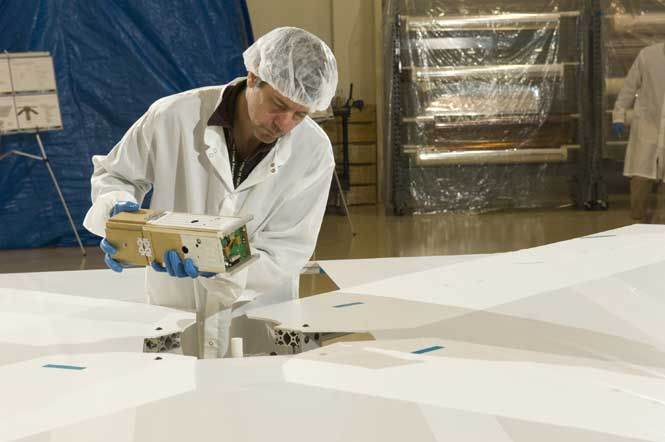 NanoSailD satellite is placed on a specially constructed surface designed for deployment testing.