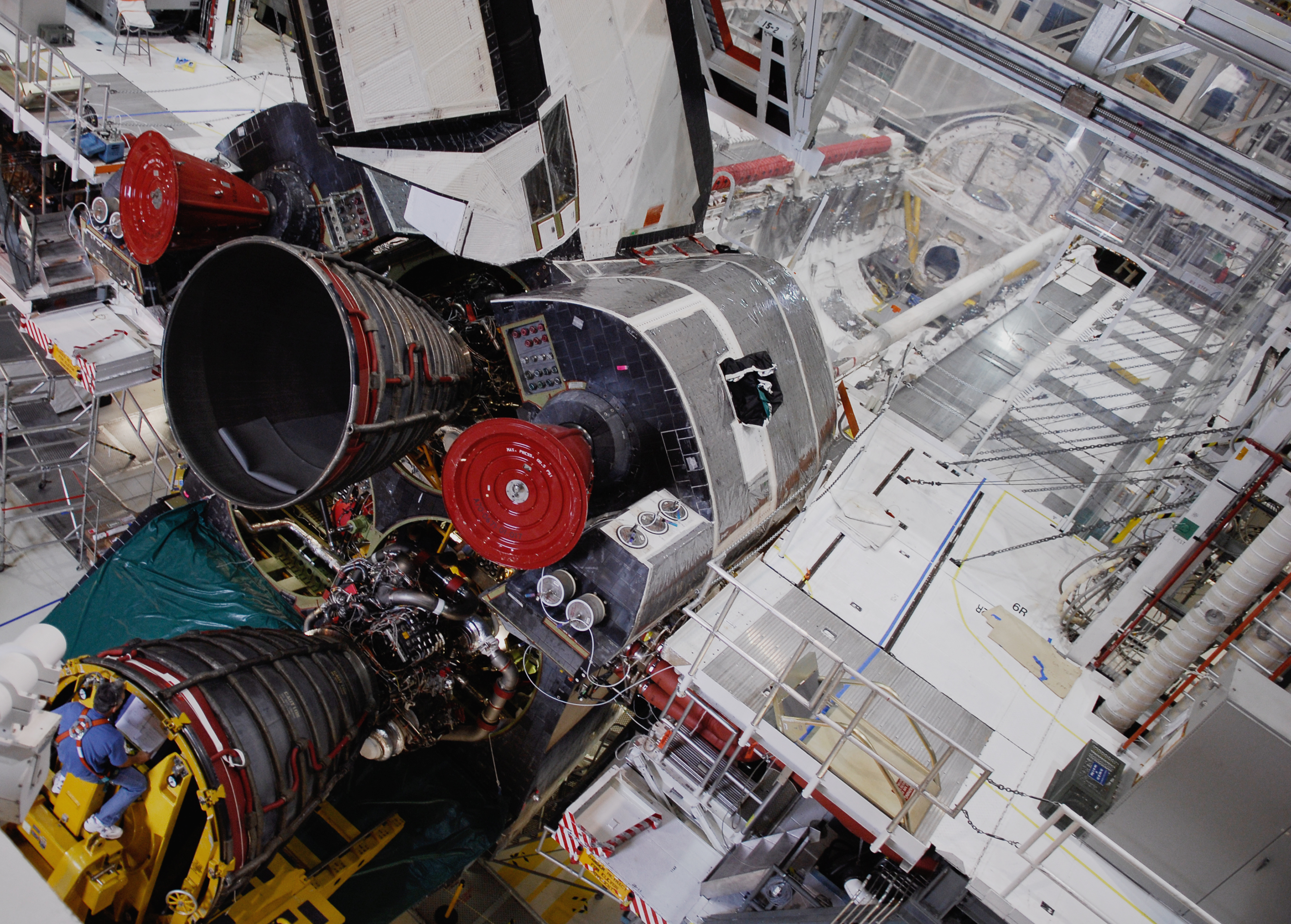 NASA - A Shuttle Main Engine is Moved Toward the Opening ...