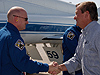 Launch Director Mike Leinbach greets STS-124 Commander Mark Kelly.