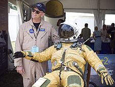 Dryden's Nils Larson shows a high altitude pressure suit, complete with a whiffle ball on the draw string