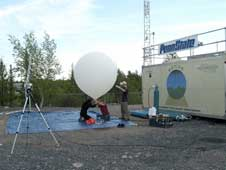 University of Toronto and Pennsylvania State University researchers prepare to launch a balloon from Yellowknife, Northwest Territories, to collect weather and ozone data.