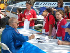 Astronaut Clay Anderson signs autographs