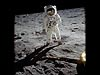 Aldrin wearing a spacesuit on the moon