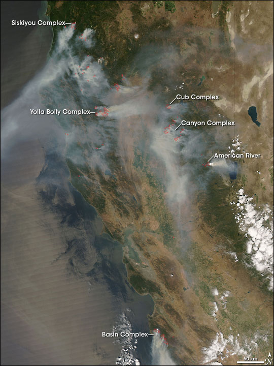 Satellite view of the state of California; MODIS-detected active fires are marked in red.