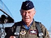 Chuck Yeager stands in front of an airplane