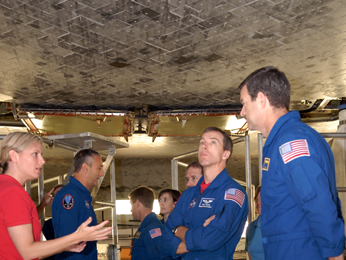 SM4 crew get a close look at space shuttle Atlantis' underside.