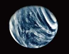 Sister planet - Venus, blanketed by a thick veil of clouds made up of sulfuric acid and water vapor, imaged by Mariner 10 in 1974.