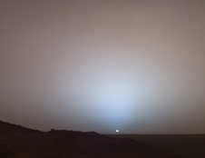 Distant sunset The Mars Exploration Rover Spirit's view of the sun (appearing 2/3 the size we see on Earth) setting below the rim of Gusev Crater on May 19, 2005, Spirit's 489th Martian day, or sol. Photo credit: NASA/JPL/Texas A&M/Cornell