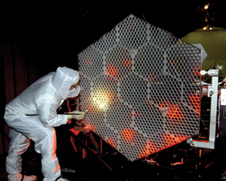 Next up - A NASA Marshall Space Flight Center employee inspects a mirror segment of the James Webb Space Telescope, scheduled for launch in 2013.
