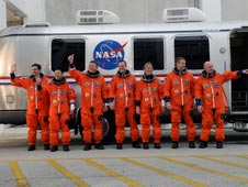 Shuttle crew in front of Astrovan.