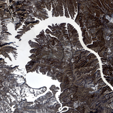 Icy dragon - Landsat 7 imagery taken Dec. 19, 1999, of the body of water formed by Bratskove Reservoir along the Angora River in southern Siberia, nicknamed Dragon Lake.