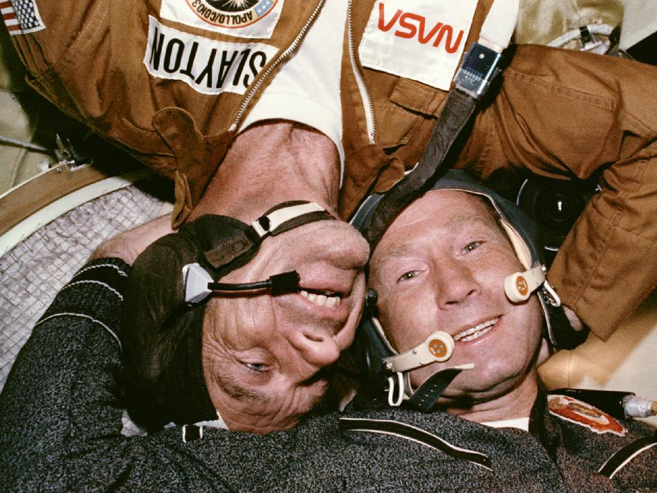 Astronaut Deke Slayton embraces cosmonaut Aleksey Leonov in the Soyuz spacecraft Click for Full Resolution Image.
