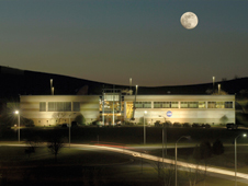 Mountaineer state moon - Full moon rising over the Independent Verification and Validation Facility in Fairmont, W.Va.