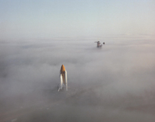 Pea soup - The space shuttle Challenger moves through the fog down the 3-mile crawler way en route to Launch Pad 39A and its first launch in April 1983. Photo credit-NASA/Amanda Diller