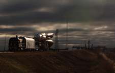 Rollout at dawn - Ingalls' stark dawn portrait of the Soyuz rocket rolling out to its launch pad. Volcanic heat
