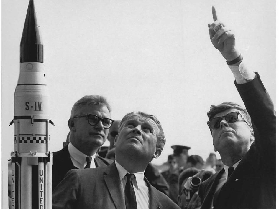 Dr. Wernher von Braun explains the Saturn Launch System to President John F. Kennedy. NASA Deputy Administrator Robert Seamans is to the left of von Braun.