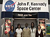 Students standing in front of a 'NASA and You' display