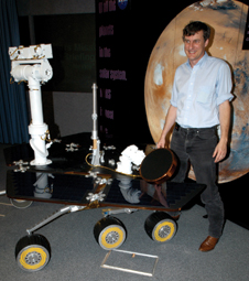 Proud principal investigator - Top-Dr. Steve Squyres, of Cornell University, principal investigator for the Mars Exploration Rover's science instruments, uses a rover model to illustrate a point during a science briefing for the media at the Kennedy Space Center.