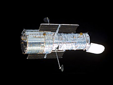 The Hubble Space Telescope floats against the blackness of space