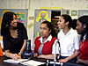 Shakira Brown talking with three teenage girls in a classroom