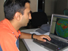 Adhikary studying a computer model that tracks forest fire emissions