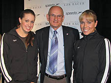 NASA researcher Steve Wilkinson with US swimmers Katie Hoff (l) and Natalie Coughlin (r)