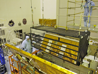 the Cosmic Origins Spectrograph, is carefully installed into its Scientific Instrument Protective Enclosure